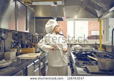 young woman chef with frying pan in the kitchen by ollyy, via ShutterStock