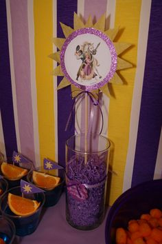 Double-sided 'Tangled' centerpiece (same image on both sides). (Tangled party.)