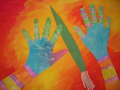 Kindergartners and first graders love the book I Ain't Gonna Paint No More! To make our projects, we used watercolor to paint designs all over our traced hands and arms. Then we painted our background with some kind of abstract design or color composition. Finally, we made our paintbrush with cut paper and chalk. The results were very nice!