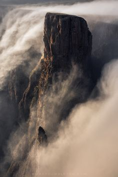 "The Falling Mist - <a href=""http://www.markdumbleton.com/landscape-tutorial/"">Landscape Processing Video Tutorials - Learn how I processed this image</a><br><br>This was one of my finest mornings of landscape photography I have ever experienced. A bland sunrise turned into an epic display of wind and mist coming from Lesotho and falling over the escarpment edge for more than an hour. The falling mist engulfed the landscape emphasizing the dynamic cliffs and pinnacles of a treacherous and…"