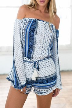 The romper is featuring blue and white printing. Elastic off the shoulder. Elastic waist.