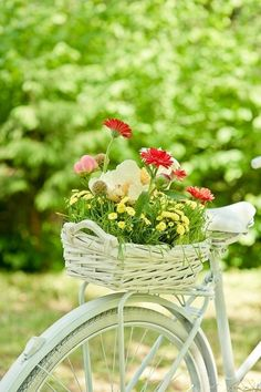I've always liked the idea of an old bicycle with a basket full of flowers.