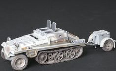 World War II German Winter WH001B SD. KFZ. 252 Armored Car with Trailer - Made by Thomas Gunn Military Miniatures and Models. Factory made, hand assembled, painted and boxed in a padded decorative box. Excellent gift for the enthusiast.