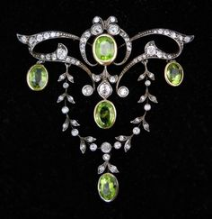 """A Victorian-era diamond and peridot brooch...  from Barbara Smith Estate & Fine Jewelry is on display at """"The Language of Jewelry"""" exhibition at the Henry B. Plant Museum in Tampa."""