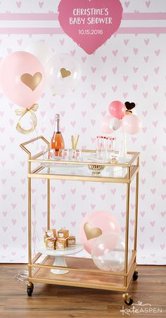 Set up a bubbly bar cart, complete with everything needed to make cocktails and mocktails for the mommy-to-be! | Gold Bar Cart | Baby Love Baby Shower by @kateaspen