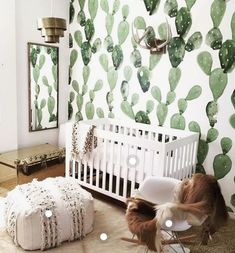 white and brown nursery with cactus art