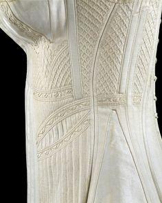White cotton corset with silk trapunto work.