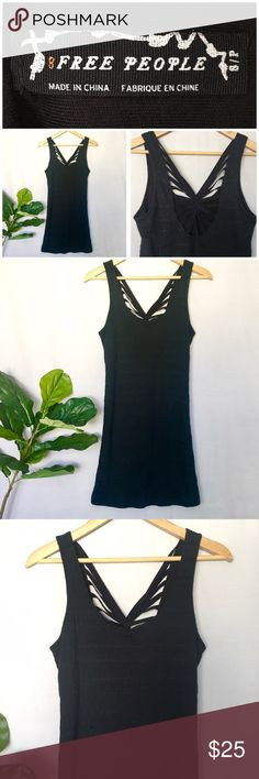 """FREE PEOPLE Black Bodycon Dress Crisscross Back Free People Black Fitted Dress Lovely black Fitted dress with crisscross design on back. Stretchy material.  In excellent condition. No holes, stains or tears.  Color: black Material: 100% Cotton  Measurements: Underarm to underarm: 29""""  Waist: 26.5"""" Hip: 30"""" Length: 33""""  Thank you for looking and please check out the rest of my closet. Free People Dresses Mini"""