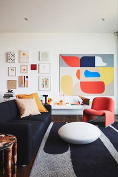 Modernist style living room filled with colourful furniture and bold artworks.