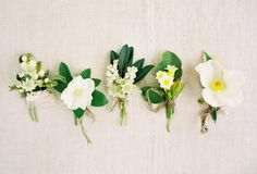 Very small white and green buttonholes