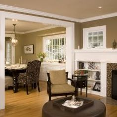 Colors between living room and dining room. Millwork around and built in bookcases.