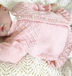 This pretty little girls jacket/sweater has beautiful detail on the bodice and a frilly cuff on the sleeves and hemline. Would also look beautiful knitted in plain white which could then be worn as part of a Christening outfit.
