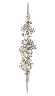 A late 19th century diamond tiara, circa 1890  The tapering floral spray with ribbon detail, set throughout with old brilliant, single and rose-cut diamonds, diamonds approx. 3.70ct. total, width 14.2cm.
