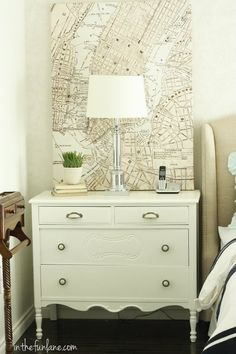 I love the use of an old map as artwork or a pop of color. Dresser as a nightstand.