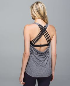 We made this tank with a draping, open back so we can keep cool in class - and show off the strappy bra underneath. Sweat-wicking with low armholes that give us room to move, it lets us focus on our practice in Hatha, Hot and Vinyasa Flow.