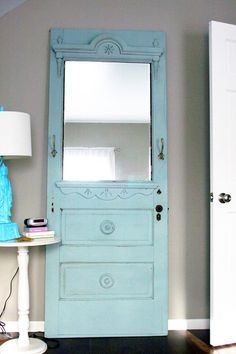 Would be cool if the two panels below mirror were drawers! Color of door is relaxing and pretty.