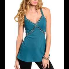 Sheer teal tunic  Sleeveless a-line tunic features a stone embellished trim and v-neck line. Pleated chest design with cross back straps. Self 100% Polyester Contrast 100% Polyester Lining 97% Polyester 3% Spandex. 24. Tops Tunics
