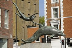 This is my favorite sculpture ever.  The Boy with a Dolphin in Chelsea Embankment London was made by David Wynne in 1975. The model for the statue was his son Roland, but sadly he died in 1999 and the statue is now his memorial.
