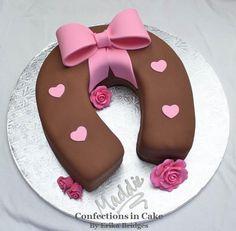 Horseshoe cake with big pink bow for a little cowgirl birthday party!