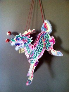 Vintage Chinese Dragon Handpainted Marionette Puppet with Feathers and Pom Poms.
