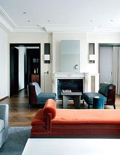 Brick velours daybed, herringbone wood floors, white marble fireplace, wood side chairs