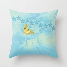 butterfly and flowers in an abstract blue grunge landscape pillow by Wendy Townrow on Society6
