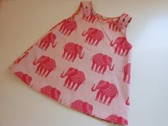 Pink elephant reversible baby dress by SweetAnnMaries on Etsy, $28.00