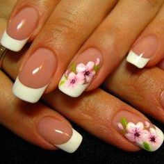 Classic French Manicure with Flower detail on the ring finger.