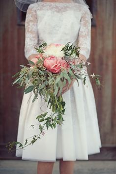 60s lace wedding dress + cascading coral peony bouquet = WOW
