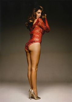 Kelly Brook booty in a red lace onesie and heels