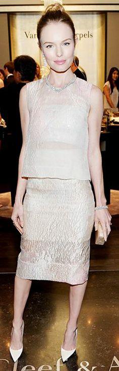 Dress – Monique Lhuillier  Jewelry – Van Cleef & Arpels  Shoes – Christian Louboutin  Purse – Edie Parker