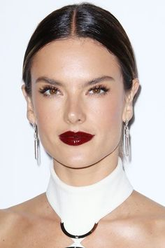 We're loving Alessandra Ambrosio's glossy lip — a departure from the usual matte and semi-matte texture.  #refinery29 http://www.refinery29.com/dark-lipstick-trend#slide-3