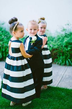 black and white stripes and a dapper suit flower girl and ring bearer | www.weddingsite.co.uk