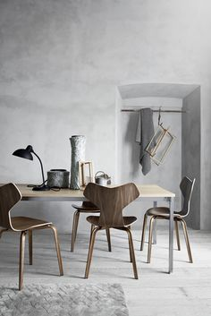 an ode to arne jacobsen - April and May grey chairs lamp rail ceramics