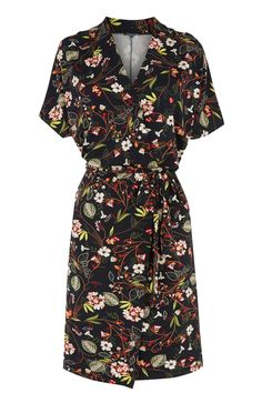 This printed wrap dress has a V neckline and self-fabric tie fastening at the waist to compliment your shape. Made from a soft jersey fabric, this dress has a loose fit and wrap skirt split from the hem to the waist.Length from shoulder seam to hem, 102cm approx. Height of model shown: 5ft 10 inches/178cm. Model wears: UK size 12.