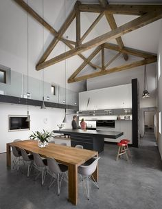 Wow - look at the beams in this modern barn conversion! Don't they look fab?! The selection of designer lighting also really gives the space presence. Get the look with the Foscarini Aplomb and Established & Sons Torch http://www.nest.co.uk/product/foscarini-aplomb-suspension-light http://www.nest.co.uk/product/established-sons-torch-group-suspension-light Image via Desire to Inspire.