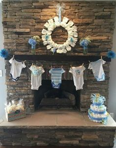 Diaper cake, diaper wreath, and baby clothes on ma… DIY baby shower decorations! Diaper cake, diaper wreath, and baby clothes on mantle/fireplace make for a … Baby Shower Party Deko, Decoracion Baby Shower Niña, Babyshower Party, Idee Baby Shower, Diaper Shower, Girl Shower, Baby Shower Games, Baby Shower Parties, Boy Baby Showers