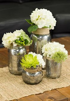Looking for a fresh take on home decor? These DIY Mercury Glass Vases will look great in any room!