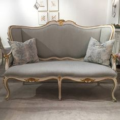The large Louis XV inspired settee from our Regent Collection features delicate floral carvings and a hand applied white finish with gilded accents. Custom upholstery is available.