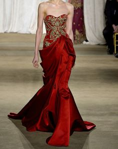 Majestic silky red gown by Naem Khan.