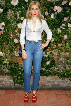 Zosia Mamet in a white crochet tie sweater and high-waisted jeans