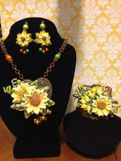 """Bohemian Vibe September Challenge """"All About Sunflowers"""" Parue. Designed with handmade polymer flowers, B'Sue heart and cuff stampings, seed bead spirals, flat back pearls, Spectra beads and book chain. Design by Irene Hoffman - Heart's Dezire"""