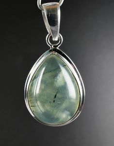 Beautiful good quality cabochon of Prehnite with Epidote mounted in sterling silver.This is unique item,you get what is on the picture.