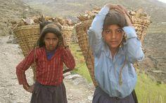 Girls from Maila Village, Humla Nepal. Basket carrying. Mountains