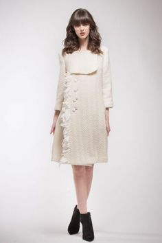 Cream coat in wool with lateral feathers