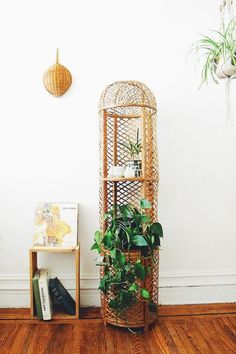 "Vintage wicker/rattan plant stand, in good vintage condition and marked ""made in Spain."""