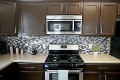Chololate painted kitchen cabinets with Rustoleum Cabinet Transformation kit.