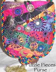 Puzzle Pieces Purse is a crazy pieced base with shisha mirror embroidery and beading.