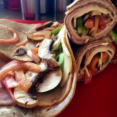 Flat Wraps - Whole Wheat Flatbread, Cream Cheese, Turkey Breast,Honey Baked Ham, Jalapeño Muenster Cheese,  Mushrooms, Green Bellpeppers, Homemade Pickles and Brined Red Onions