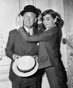 1957   With Maurice Chevalier, filming Love in the Afternoon.